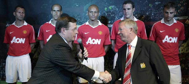 541aa1ba1 Aon CEO Greg Case shakes hands with Manchester United team manager Alex  Ferguson after they unveiled