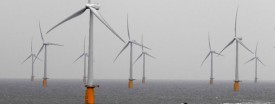 A boat powers past the Thanet Offshore Wind Farm, the world's largest operational offshore wind farm, off the Kent coast in southern England, Sept. 23, 2010. (Reuters/Stefan Wermuth)
