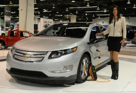 A model stands next to the Volt in October. (Mark Ralston/AFP/Getty Images)