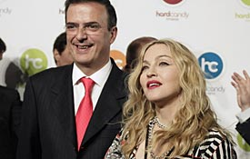 U.S. singer Madonna smiles with Mexico City Mayor Marcelo Ebrard at the opening of her Hard Candy Fitness gym in Mexico City. (Henry Romero/Reuters)