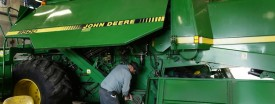 A John Deere combine being worked on in Hampshire, Ill. Moline-based Deere is expanding into Russia. (Photo by Scott Olson/Getty Images)