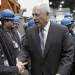 Gov. Pat Quinn and U.S. Sen. Dick Durbin greet workers at the Amtrak Rail Yard. (Michael Tercha/Tribune)