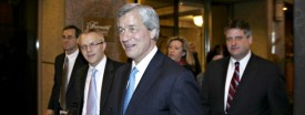 Jamie Dimon, center, chairman and chief executive officer of JPMorgan Chase & Co. (Tim Boyle/Bloomberg News)