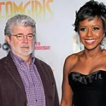 "Movie director George Lucas and Mellody Hobson attend the 2009 opening night of ""Dreamgirls"" at The Apollo Theater in New York City. (Jemal Countess/Getty)"