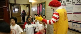 Ronald McDonald slaps first graders hands as they head to lunch at Charles Gates Dawes Elementary School  in 2008. (Heather Stone/Chicago Tribune)