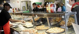 A Sbarro Inc. employee serves patrons at a restaurant in Columbus, Ohio. (Reuters_